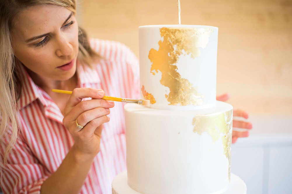 Elizabeth Harris Cakes Personal Branding Photography decorating gold wedding cake