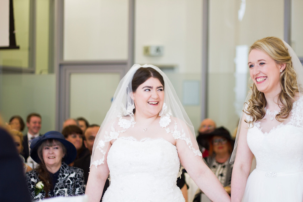 happy brides during their wedding ceremony at liver building liverpool