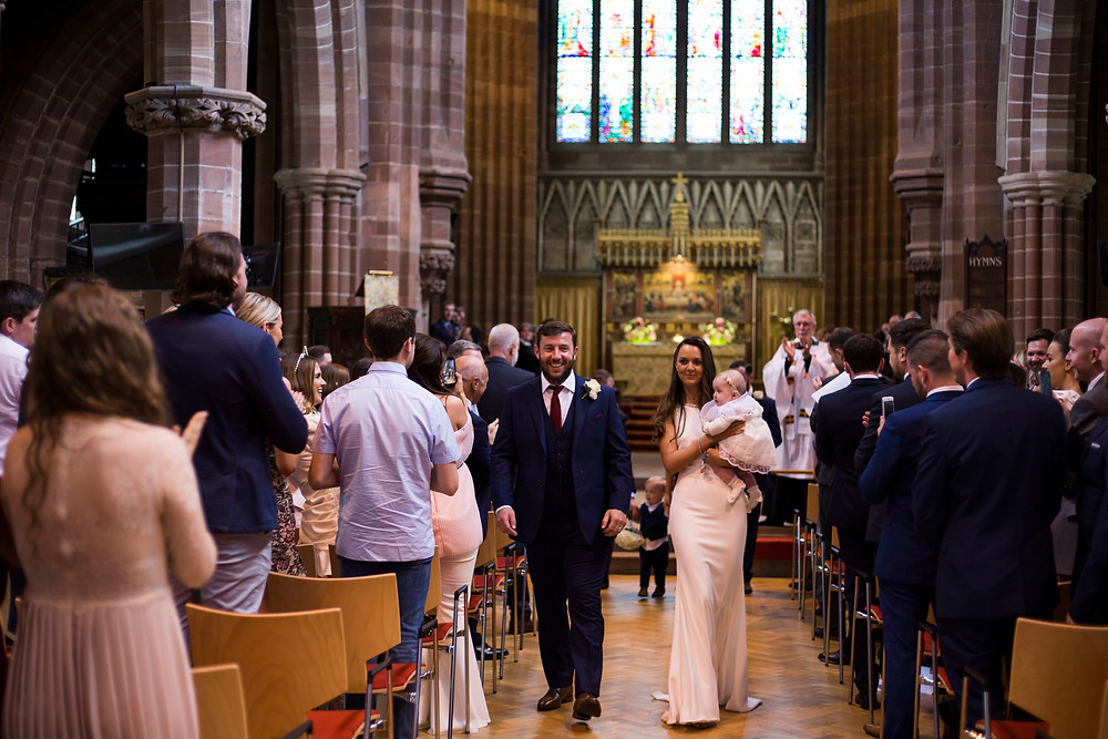 Bride and groom walking down the aisle at their liverpool wedding ceremony