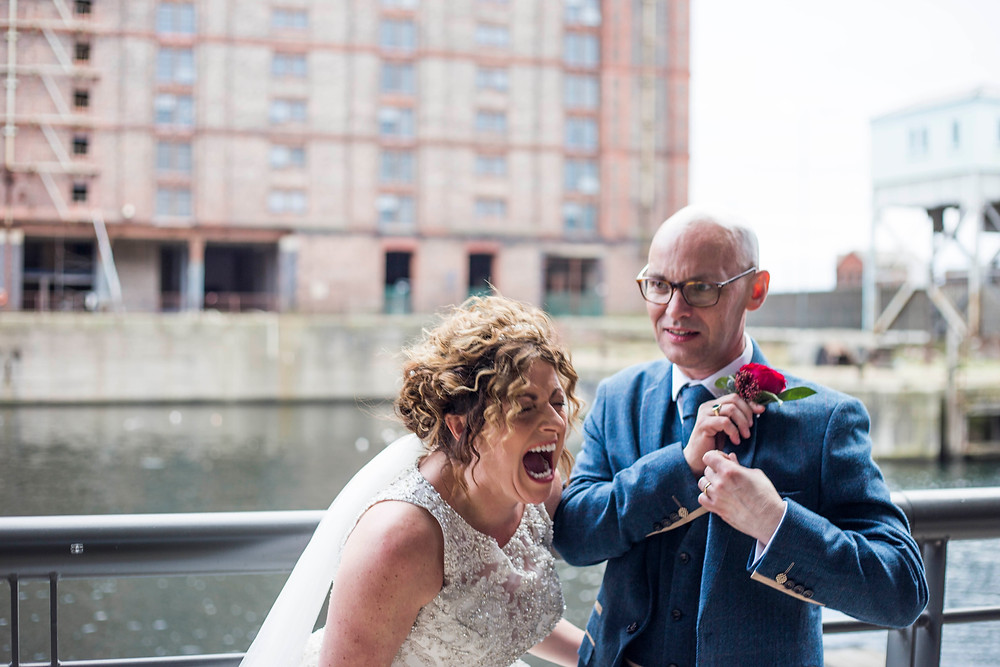 Bride and groom laughing at Titanic Hotel Liverpool