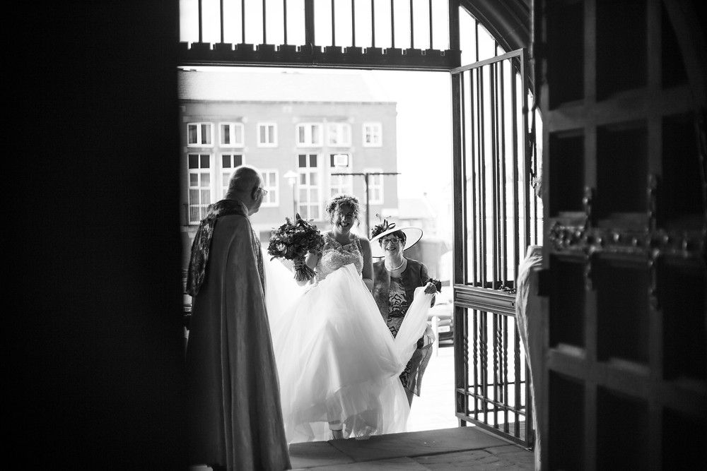 Bride entering the Lady chapel for her wedding ceremony at Liverpool Cathedral