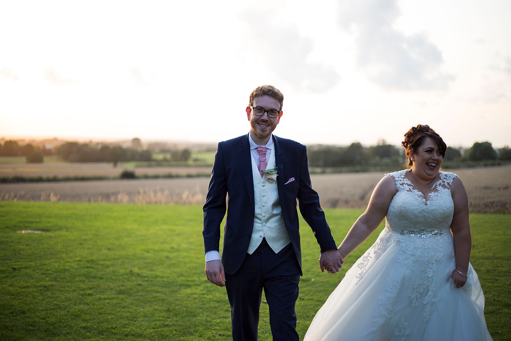 Bride and groom infront of wheat field and sunset at West Tower Wedding venue