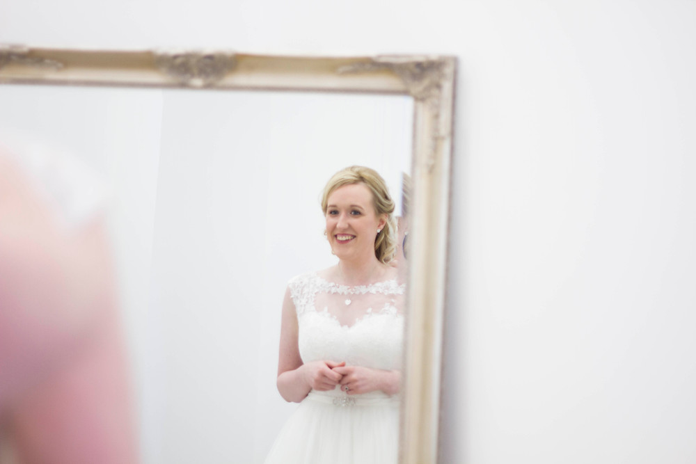 bride seeing herself in her dress for the first time
