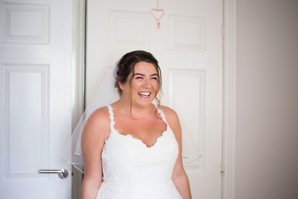 Bride smiling in her wedding dress