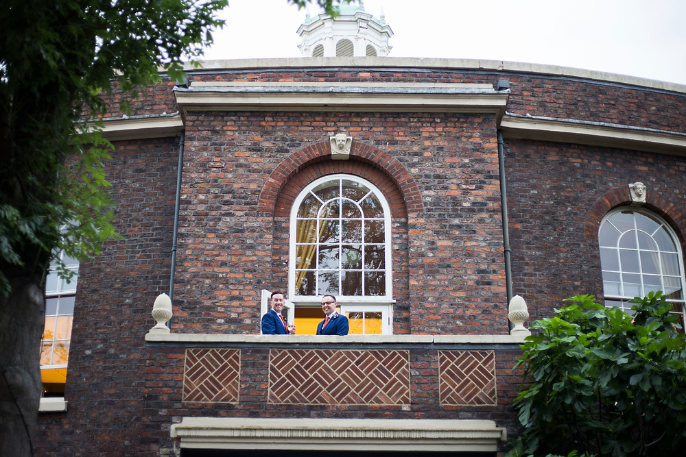 Grooms on the balcony of The Bluecoat