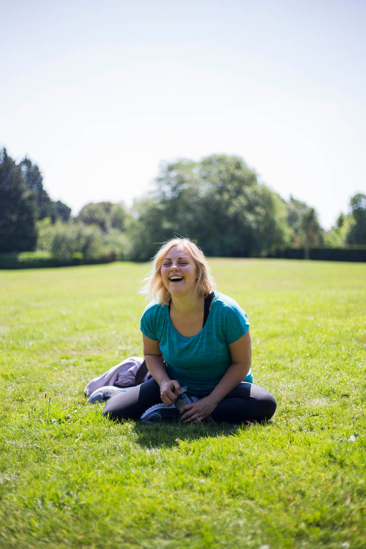 Relaxed headshot of female personal trainer laughing outdoors. Personal Branding Photography Liverpool
