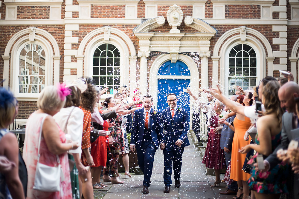 Grooms and confetti tunnel outside The Bluecoat Liverpool Wedding