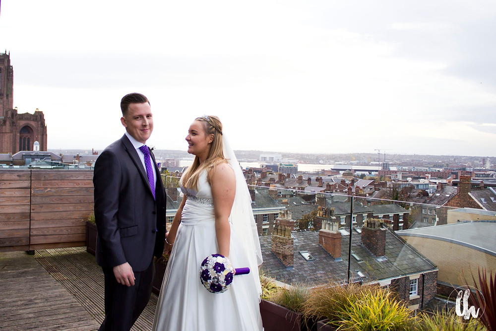 Bride and groom on the balcony of Hope Street Hotel