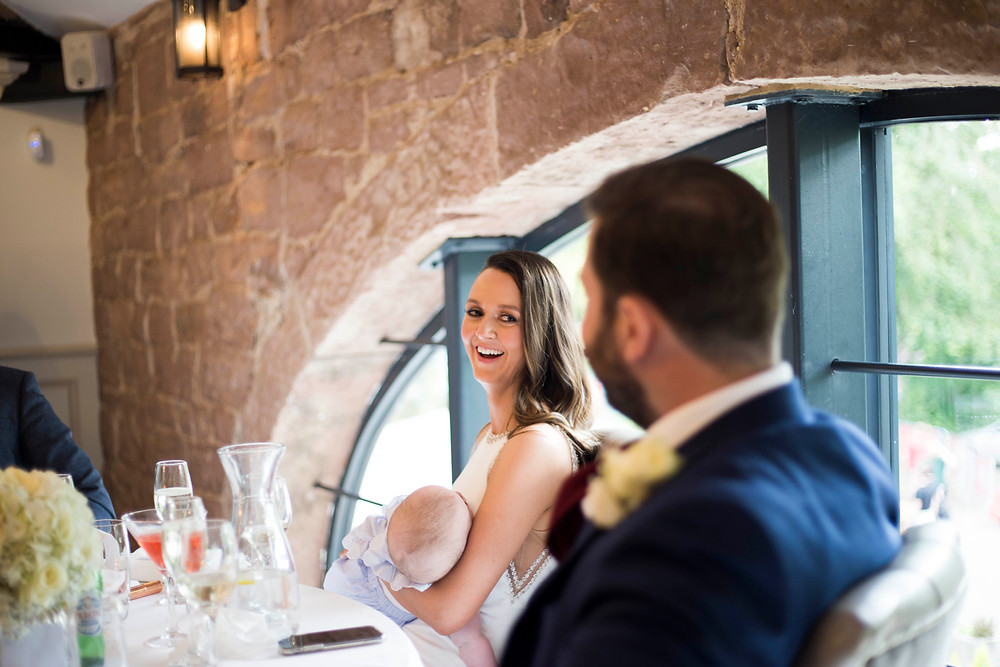 Bride laughing during speeches at Hayloft Allerton Manor Wedding