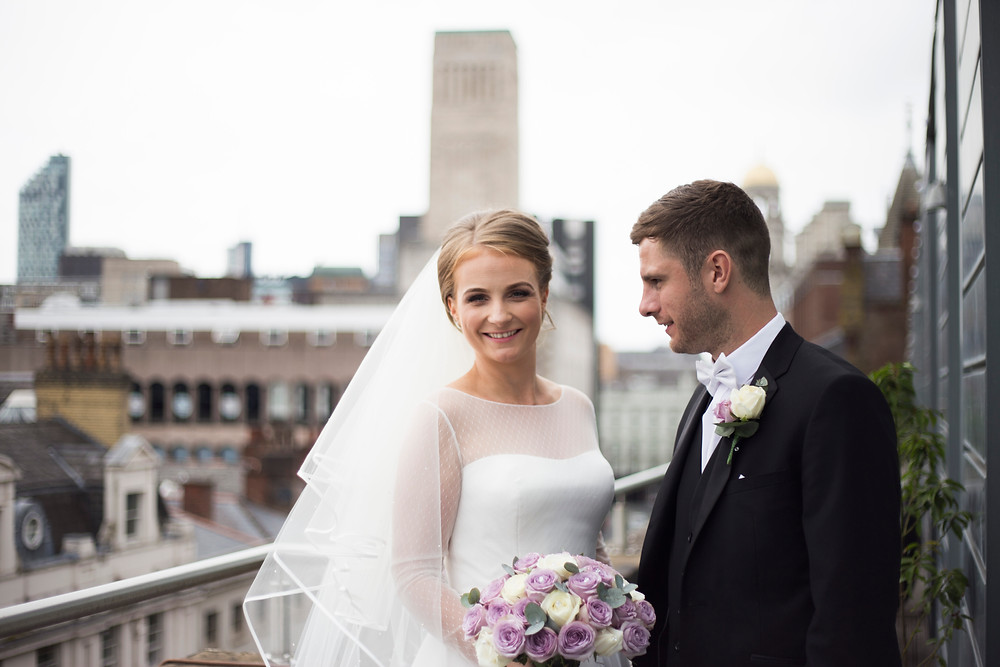 Bride and groom on balcony at Hard Days Night Hotel