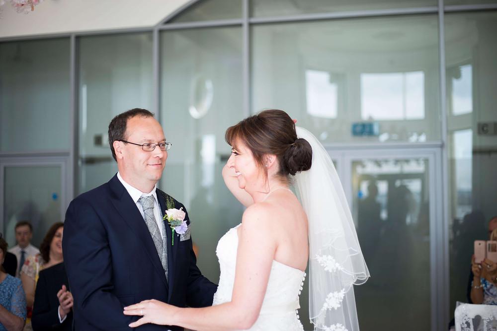 Bride and groom liver building wedding