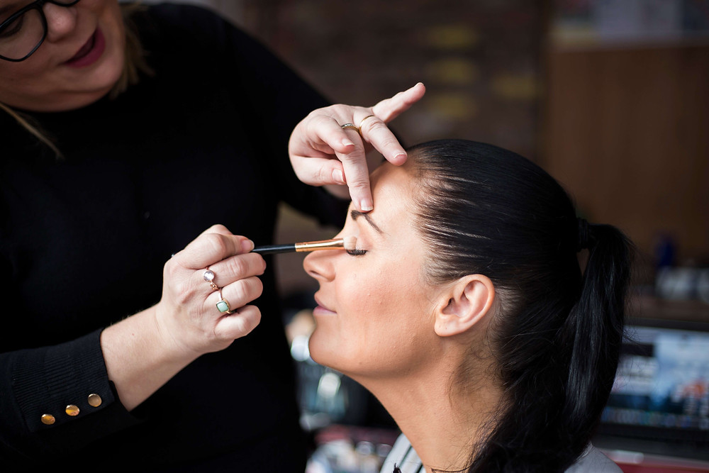 Female having makeup done by Liverpool Makeup Artist Glamorama Makeup. Behind the scenes personal branding photography