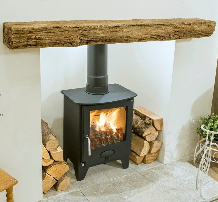 imitation timber beam made from concrete above a stove fit.