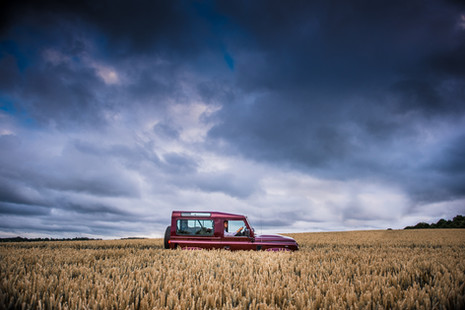 Litherland Photo Land Rover Defender off road driving in corn field