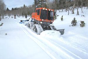 Ski slope trail grooming machine - iconography used for Squarespace trailing slash/ blog post