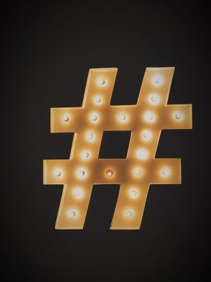 A hashtag sign done old-school with incandescent light bulbs - Las Vegas style