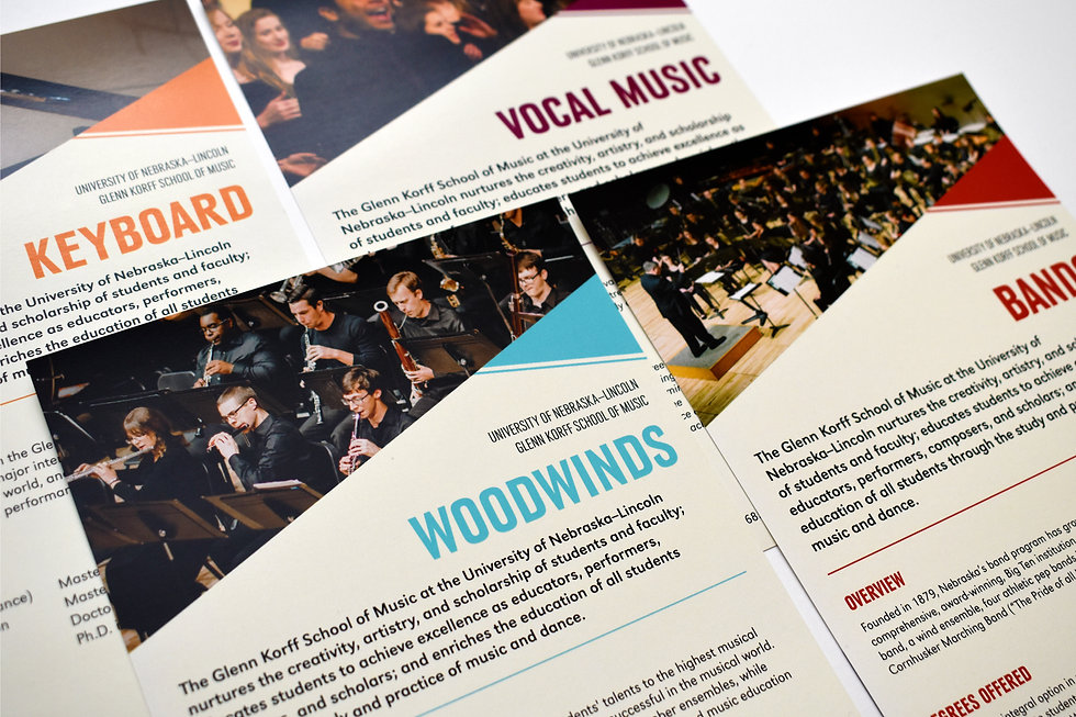 "Detail photo of four half-page handouts. The handout in the foreground reads ""Woodwinds"" in blue text and shows a picture of a woodwind section performing."