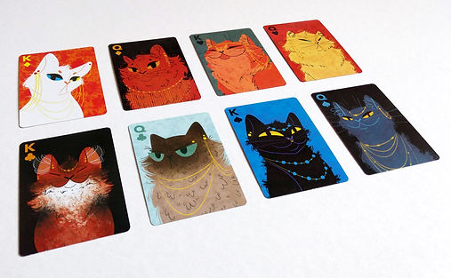 King and queen playing cards lined up in two rows on a white background. Each card contains a different cat illustration.