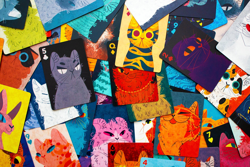 Playing cards piled on top of one another. Each card contains a bust illustration of a different cat breed.