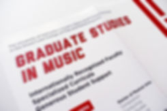 Detail photo of graduate studies poster. The title, in a sporty, red font on a white background, reads Graduate Studies in Music.
