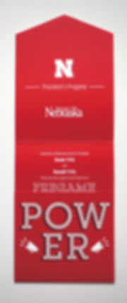 """Photo of a partially-opened tri-fold invitation. All panels are red with white text. The top panel shows the University of Nebraska logos and the words """"President's Pregame."""" The bottom panel reads """"POWER"""" with two silhouettes of megaphones. The center panel is only partially visible."""