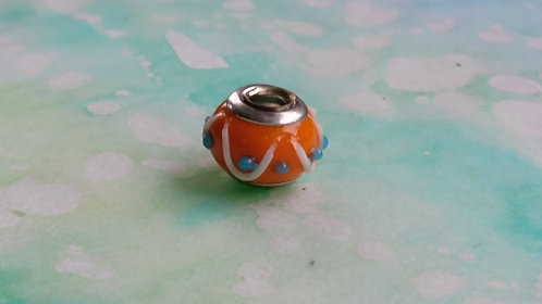 Orange glass and silver bead