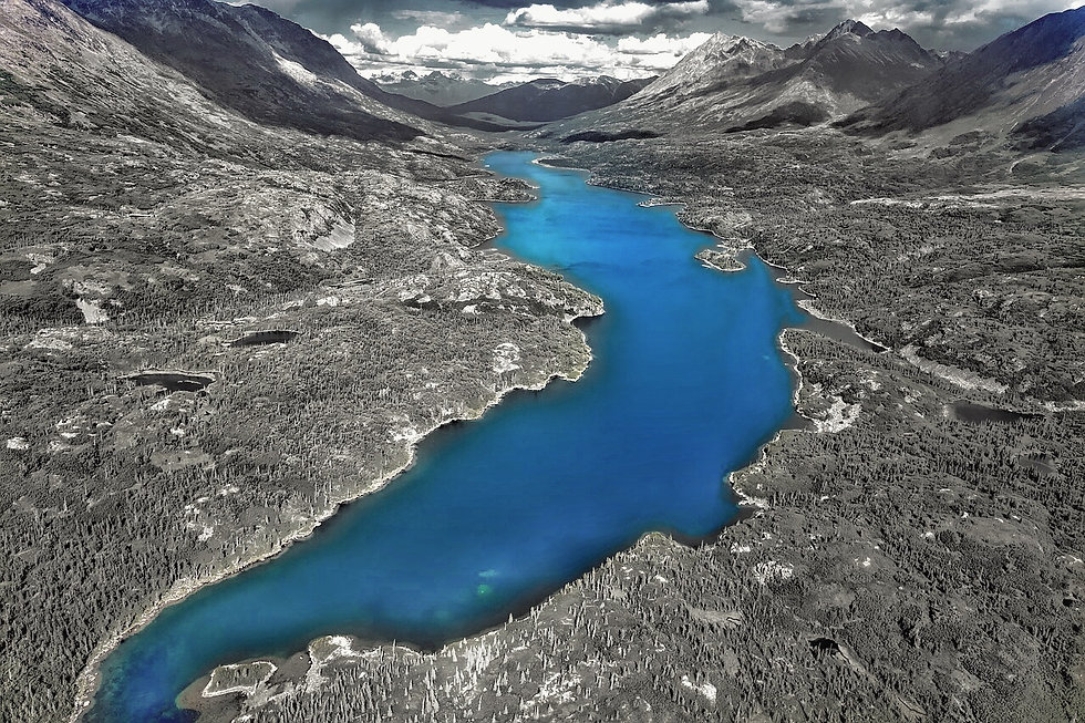 Artistic image of the blue river between two black and white mountains