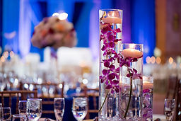 Table decor of candles and florals at a wedding.