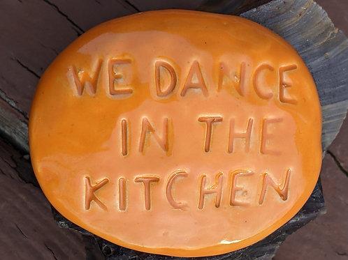 WE DANCE IN THE KITCHEN Pocket Stone - Pumpkin Orange