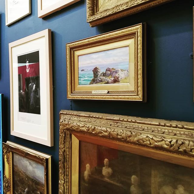 Dark wall colours with gold frames