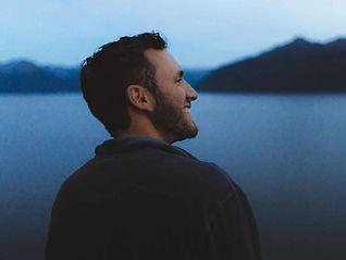 Man smiling looking at Alaskan scenerary