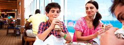 Boy eating a sandwich with his mom