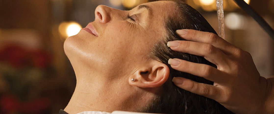 woman relaxed getting a facial