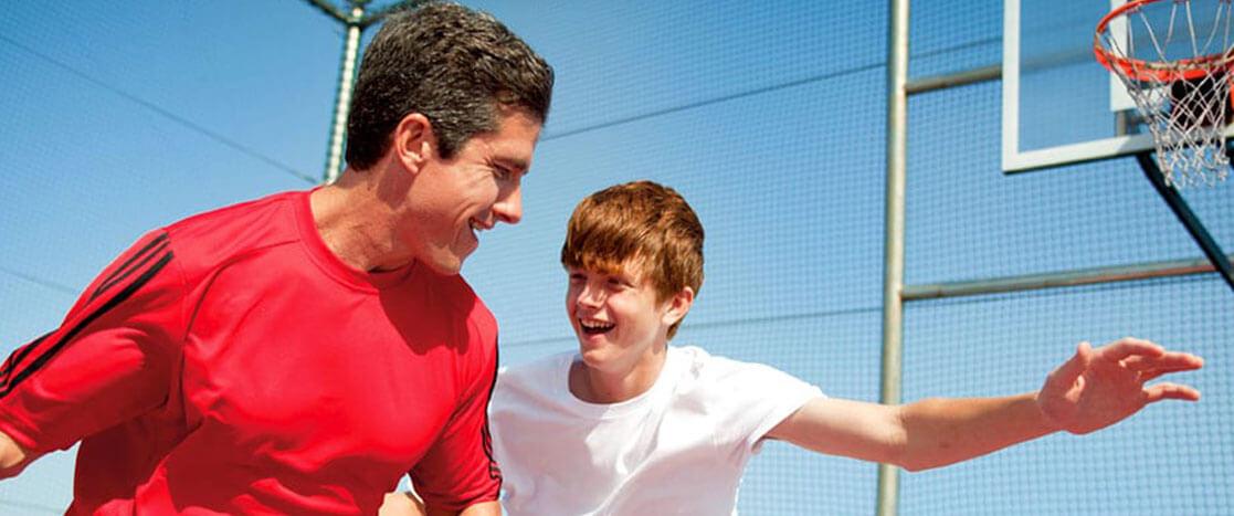 Father and Son playing basketball