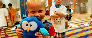 little boy holdin a stuffed animal