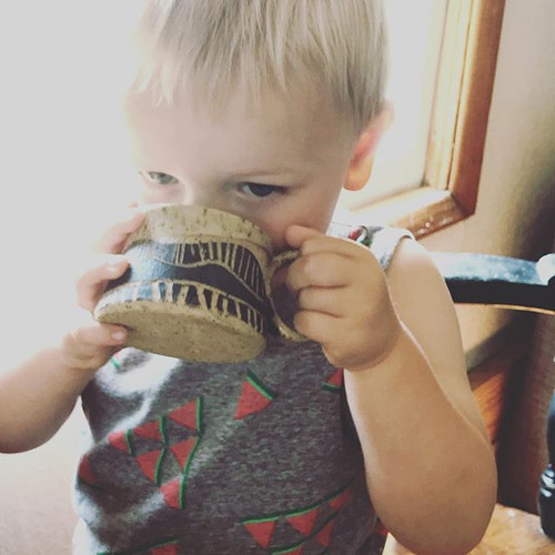 My own little cutie trying out the toddler mug.jpg