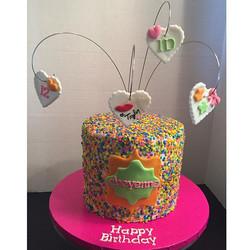 bright confetti double barrel cake