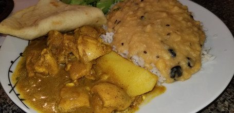 Curry chicken, rice and dhal and roti