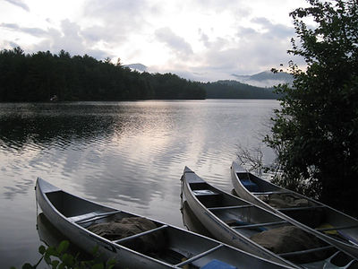 Canoes on lake, mountains, water