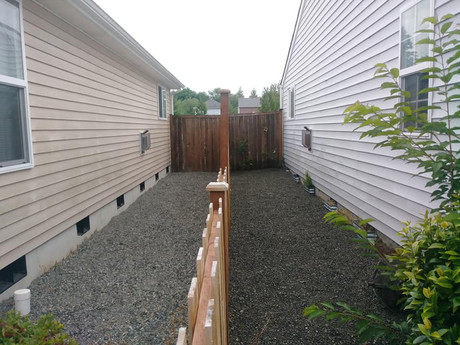 Laying rock between houses