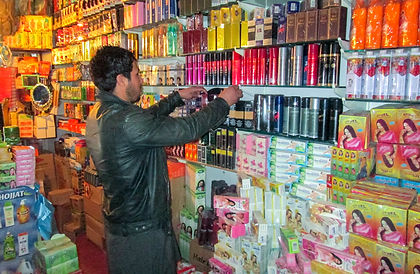 Afghan man in cosmetics shop