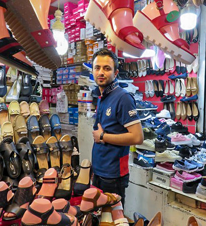 Young man selling shoes