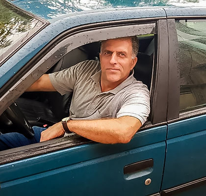Close up of man in car