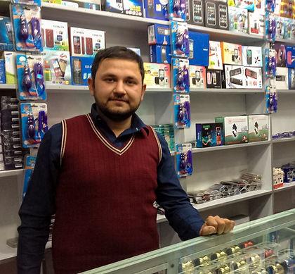 Afghan man in mobile phone shop