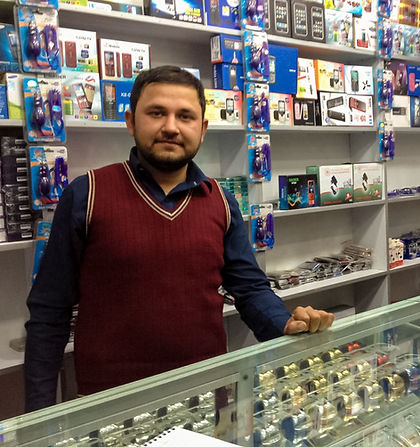 Afghan man in mobile phone shop