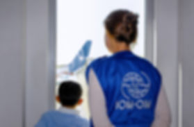 IOM assistant and child at airport