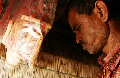Man making tea in Bangladesh