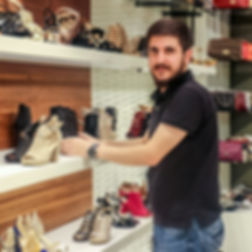 Iraqi man working in shoe shop