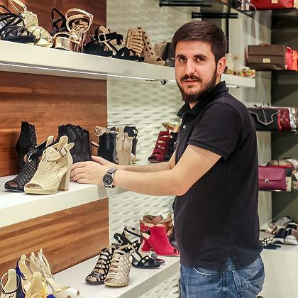 Iraqi man working in shoe shop