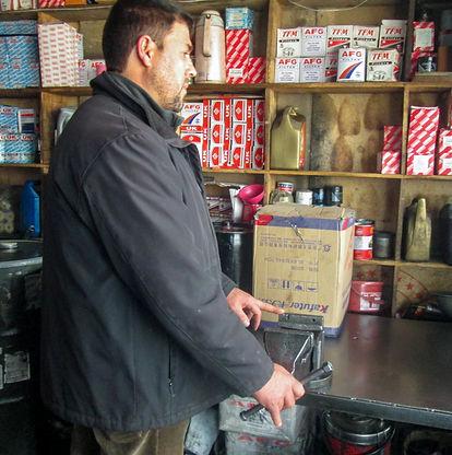 Afghan man in workshop